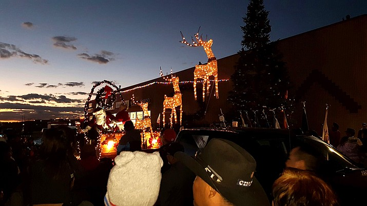 As the sun set in Tuba City Dec. 1, a fully lit Santa sleigh with reindeer, driven by Santa and Mrs. Claus, arrived for the lighting of the 45 foot Christmas tree in the Bashas Shopping Center. Rosanda Suetopka/NHO