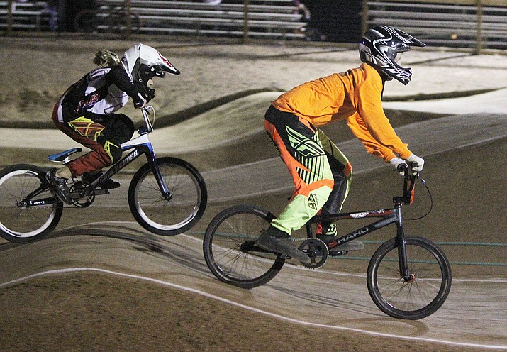 Racers participate in regular BMX racing last year at the Kingman track at Mohave County Fairgrounds. The Board of Supervisors approved a contract Monday for Custom Opts BMX to operate the track in Bullhead City. Custom Opts will also be taking over the Kingman track.
