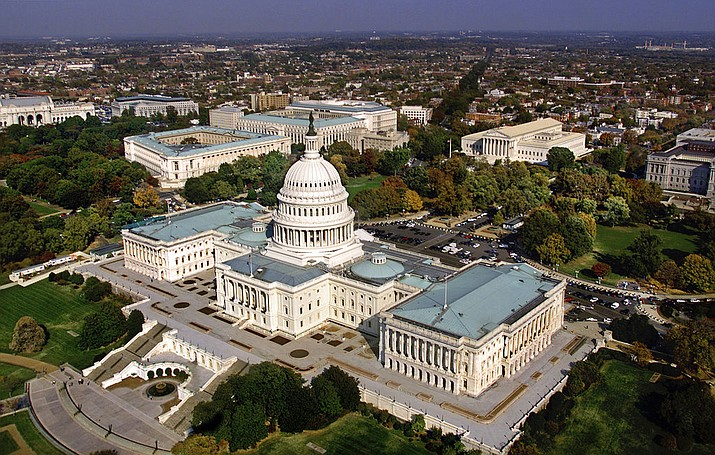 FILE - In this file photo, the United States Capitol in Washington, D.C. is shown in an aerial view. The GOP-led Congress is hoping to approve a must-pass spending bill as the clock ticks toward potential government shutdown this weekend. (AP Photo/J. Scott Applewhite, File)