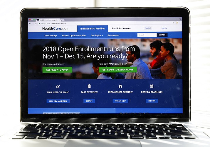 In this photo, the Healthcare.gov website is seen on a computer screen in Washington. The government says about 8.8 million people have signed up for coverage next year under the Affordable Care Act. A deadline surge last week appears to account for the surprisingly strong numbers. (AP Photo/Alex Brandon)