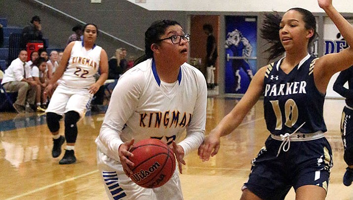 Kingman High's Tarase Marshall hit the game-winning 3-pointer to give the Lady Bulldogs a 54-53 win at Parker Wednesday night.
