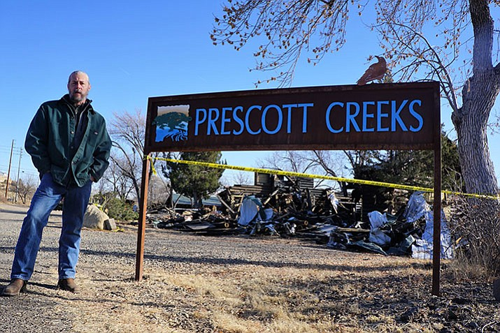 Since the Dec. 10 fire that destroyed much of the 1950s-era log cabin that housed the Prescott Creeks organization, Executive Director Michael Byrd has been working to salvage what he can from the wreckage. The organization has rented the high-profile office space along Highway 89 since late 2013. (Cindy Barks/Courier)