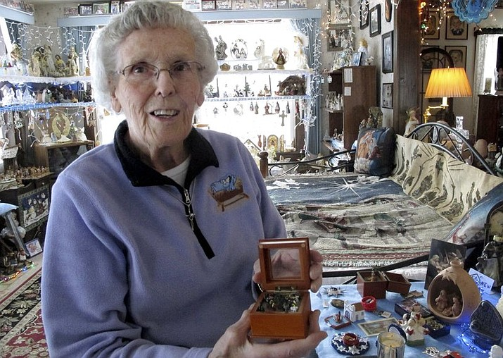 In this photo, Shirley Squires, of Guilford, Vt., speaks with a reporter about her collection of more than 1,400 nativity scenes on display in her home. Each Christmas, she gets help putting up the miniature scenes and then opens her home to school groups and others for viewing. (AP Photo/Lisa Rathke)
