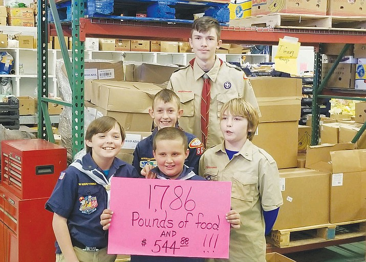 Area members of the boys and cub scouts raised 1,786 pounds of food and $544.48 for Kingman Area Food Bank that used during this holiday season.