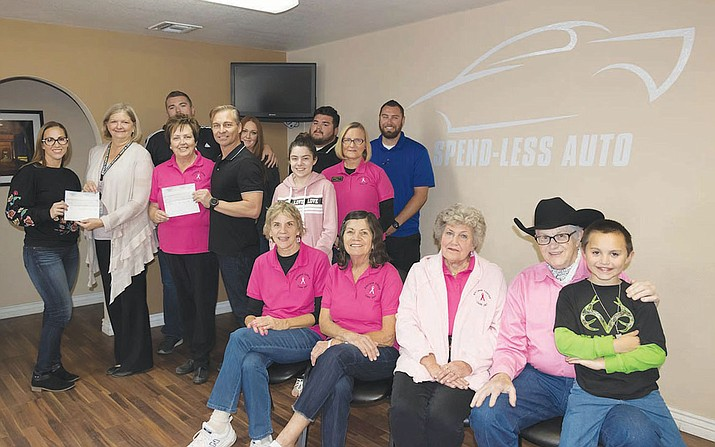 Employees of Spend-Less Auto gather with members of the Kingman Cancer Care Unit and KRMC's Catch It Early to present their donations. From left to right: Brandy Ramirez, Teri Williams, Cody Martinez, Janet Watson, Zeferino (Zef) Ramirez, Felicia Dorsey, Alayna Chavira, Jose Anastacio, Linda Kaufman, Shawn Campbell. Front row: Coral Coolahan, Cindy Wallace, Doris Panik, Michael Malysz Sr., Michael Malysz III.