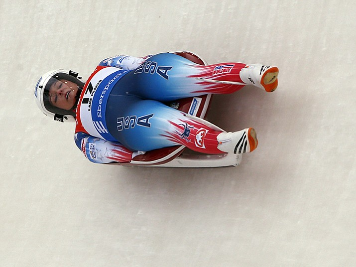 In this Dec. 16, 2017, file photo, Emily Sweeney takes a curve during a World Cup luge event in Lake Placid, N.Y. Sweeney is one of three members of USA Luge's women's team that is headed to Pyeongchang, South Korea, for the winter Olympics.