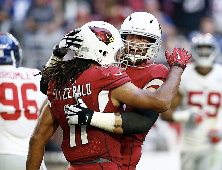 Arizona Cardinals wide receiver Larry Fitzgerald (11) celebrates his touchdown with offensive guard Alex Boone during the first half of an NFL football game against the New York Giants, Sunday, Dec. 24, 2017, in Glendale. (Ross D. Franklin/AP)