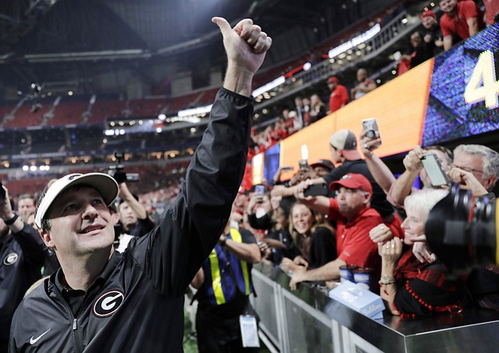 In this Dec. 2, 2017, file photo, Georgia head coach Kirby Smart celebrates after the Bulldogs defeated Auburn 28-7 in the SEC championship in Atlanta. (David Goldman/AP, File)