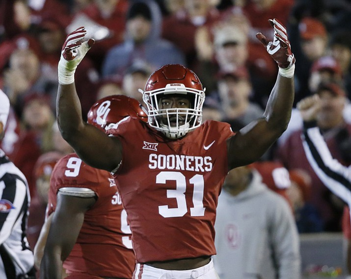 In this Oct. 28, 2017, file photo, Oklahoma defensive end Ogbonnia Okoronkwo (31) gestures to the crowd in the third quarter of an NCAA college football game against Texas Tech, in Norman, Okla. Okoronkwo was selected to the AP All-Conference Big 12 team announced Friday, Dec. 8, 2017. (Sue Ogrocki/AP, File)