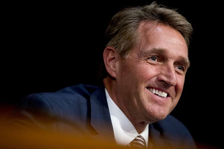 Sen. Jeff Flake, R-Ariz., asks questions during a Senate Committee on Capitol Hill in Washington. Flake said President Donald Trump is certain to face an independent challenge in the next presidential election, if not a challenge from within the party. And Flake is not ruling out being that challenger. (AP Photo/Andrew Harnik, File)