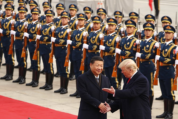 FILE - In this Nov. 9, 2017, file photo, President Donald Trump and Chinese President Xi Jinping participate in a welcome ceremony at the Great Hall of the People in Beijing, China. (AP Photo/Andrew Harnik, File)