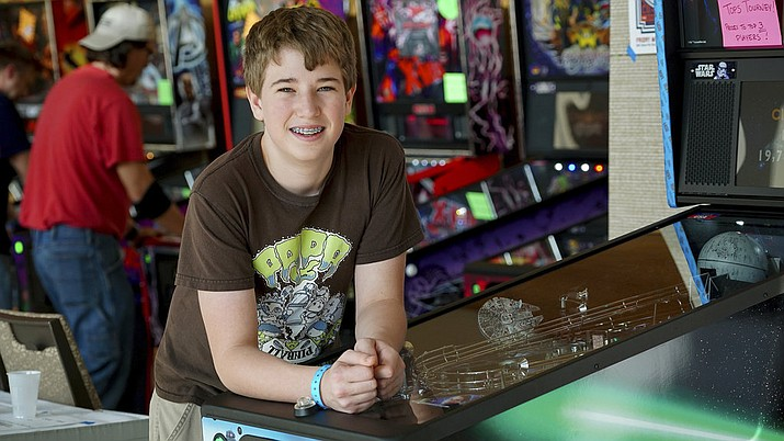 In this Oct. 13, 2017 photo, Escher Lefkoff poses for a photo at the Pinball Expo 2017 in Chicago. Lefkoff won the Professional and Amateur Pinball Association's World Championships last spring. (AP Photo/Teresa Crawford)
