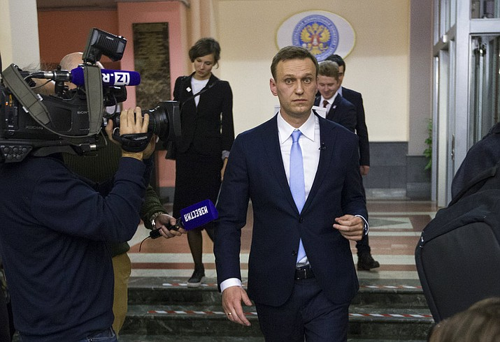 Russian opposition leader Alexei Navalny, center, leaves the Russia's Central Election commission in Moscow, Russia, Sunday, Dec. 24, 2017. The 41-year-old anti-corruption crusader has run a yearlong grass-roots campaign and staged waves of rallies to push the Kremlin to let him run. (AP Photo/Ivan Sekretarev)