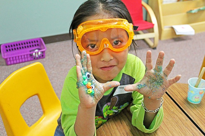A student from Hulet Elementary School in Holbrook gets her hands dirty during the day's activities. Submitted photos