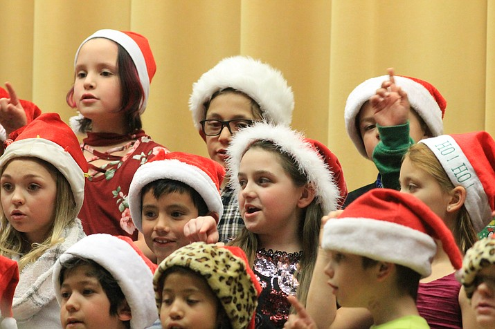 Williams Elementary second and third grade students sing songs and perform skits for their annual holiday shows Dec. 19.