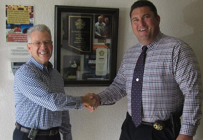 Pastor Dale Ray, the 2017 recipient of the Volunteer of the Year Award, shakes hands with Mohave County Sheriff Doug Schuster. (Courtesy Photo)