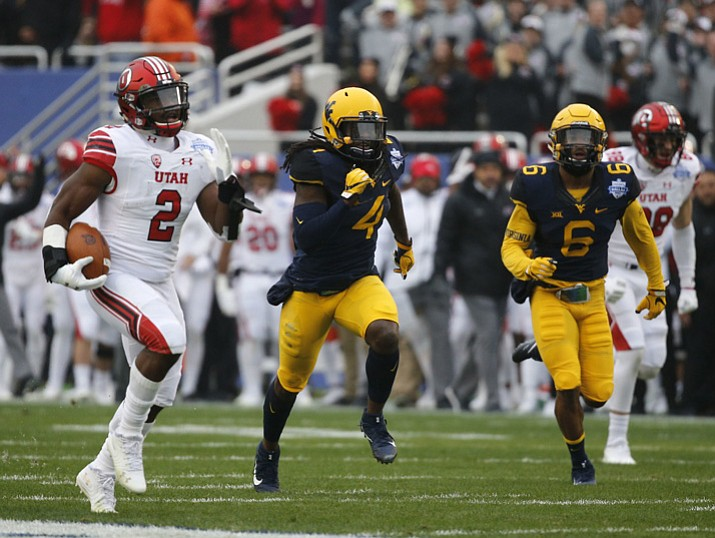 Utah running back Zack Moss (2) runs for a touchdown against West Virginia during the first half Tuesday, Dec. 26, 2017. (Rose Baca/The Dallas Morning News via AP)