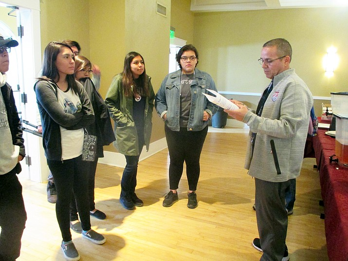 Phoenix Indian School property manager Phillip Galaviz gives Hopi High students a tour of Phoenix Indian School. Stan Bindell/NHO