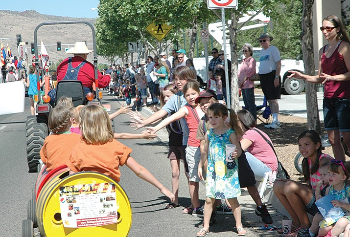 Prescott Valley residents enjoying one of the many parades to bring community to the valley. (Tribune file photo)