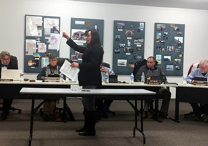 Central Yavapai Fire District board member ViciLee Jacobs presents copies of a statement she prepared for other board members and staff regarding her stance on particular issues she is concerned about during the Thursday, Dec. 21 meeting. (Max Efrein/Courier)