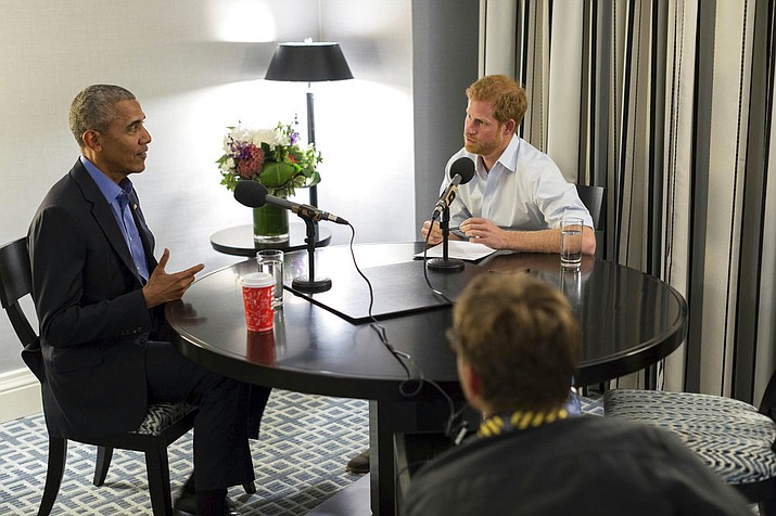 In this undated photo issued on Sunday Dec. 17, 2017 by Kensington Palace courtesy of the Obama Foundation, Britain's Prince Harry, right, interviews former US President Barack Obama as part of his guest editorship of BBC Radio 4's Today programme which is to be broadcast on December 27, 2017. (Kensington Palace courtesy of The Obama Foundation via AP)