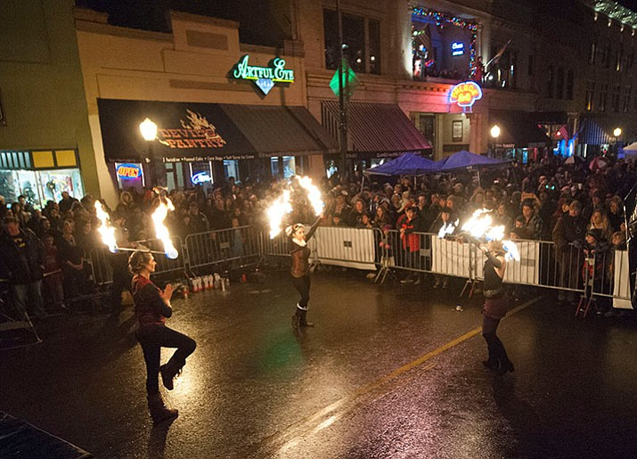 The Nuriya Fire Dancers entertain the large crowd at the 6th Annual Whiskey Row Boot Drop in downtown Prescott Saturday, Dec. 31. (Les Stukenberg/The Daily Courier)