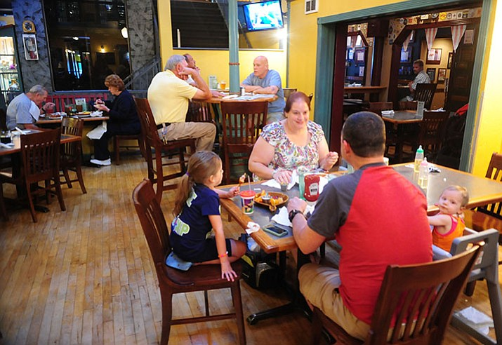 Diners enjoy their food at the Prescott Brewing Company in 2015. The hospitality industry has seen the largest increase in wages since Arizona voters approved an increase to the state's minimum wage in 2016.