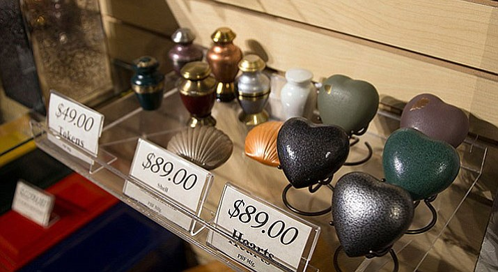 At Wyman Cremation & Burial Chapel in Mesa, people can purchase small urns, also known as tokens, if family members wish to divide their loved one's ashes.