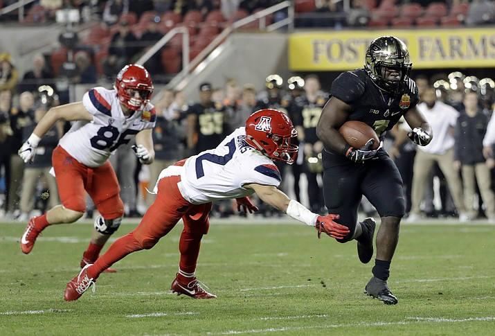 Purdue running back D.J. Knox, right, runs past Arizona cornerback Lorenzo Burns (2) for a touchdown during the first half of the Foster Farms Bowl NCAA college football game Wednesday, Dec. 27, in Santa Clara, Calif. (Marcio Jose Sanchez/AP)