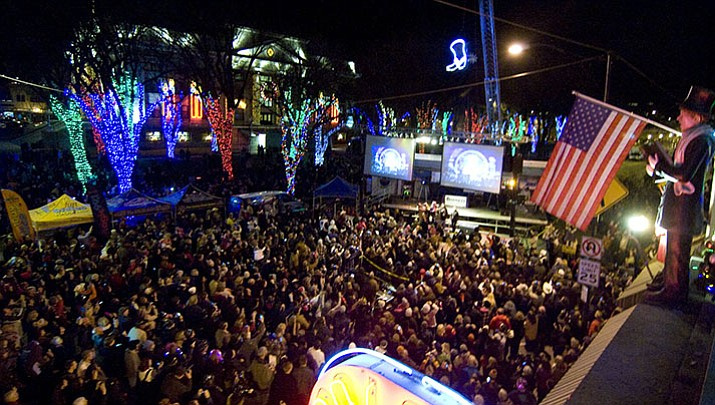 New Year's Eve partiers blanket Montezuma Street and Whiskey Row at the Boot Drop. This year's event is the seventh annual.