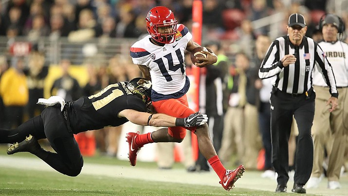 Khalil Tate threw five TD passes in a 38-35 loss to Purdue Wednesday night in the Foster Farms Bowl.