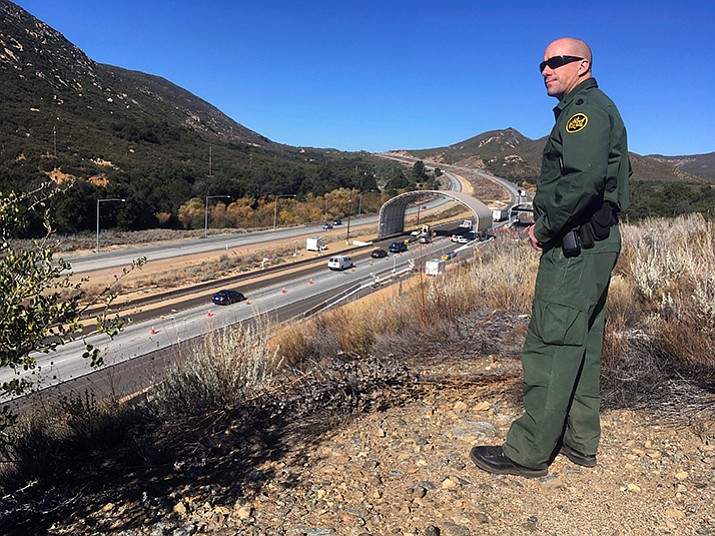 In this Thursday, Dec. 14 photo, Border Patrol agent Troy Hunt looks over California's Pine Valley checkpoint, on the main route from Arizona to San Diego. (AP Photo/Elliot Spagat)