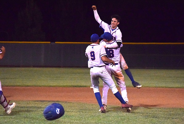 Camp Verde baseball players celebrate senior John Castillo's walk off double in extra innings on Senior Night against Northland Prep. The win clinched the region championship for the Cowboys. (VVN/James Kelley)