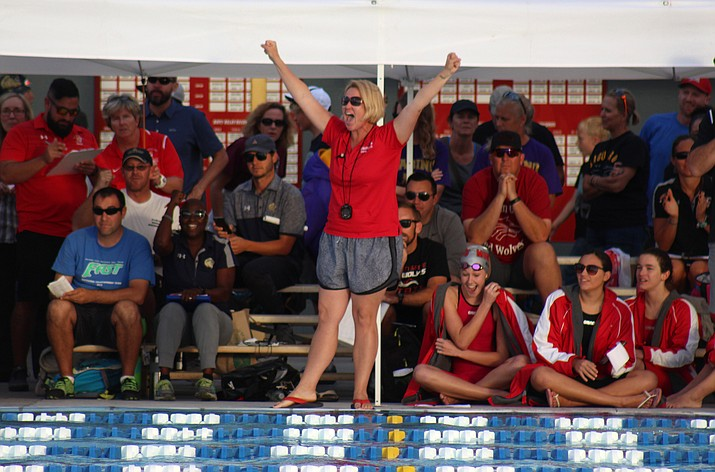 Mingus swimming head coach Gretchen Wesbrock celebrates the Marauders' win in the boys 200 freestyle relay at the state meet at the Phoenix Country Day School Dady Aquatic Center in Paradise Valley. (VVN/James Kelley)