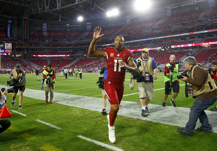 This Dec. 24, 2017, file photo shows Arizona Cardinals wide receiver Larry Fitzgerald (11) leaving the field after an NFL football game against the New York Giants in Glendale. Fitzgerald might well be the most popular athlete in the history of the state of Arizona. The wide receiver's resume is packed with Hall of Fame-caliber statistics accumulated over 14 seasons with the same Cardinals team that drafted him third overall in 2004. Add to that his easy-going personality combined with a remarkable durability, he's missed six games of his 208 games since joining the league. A year ago, Fitzgerald and the Giants' Eli Manning shared the NFL man of the year award his work off the field. (Ross D. Franklin/AP, File)