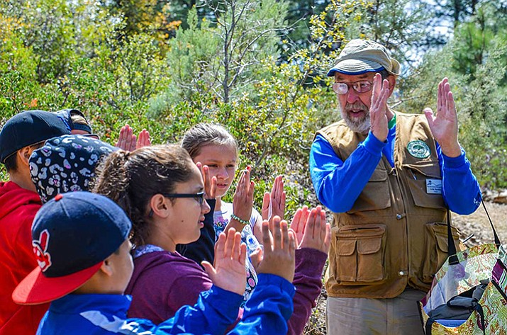A Highlands Center docent works with a group of children. Volunteer opportunities at the center are many — ranging from naturalists and docents to help in the office. (Courtesy)