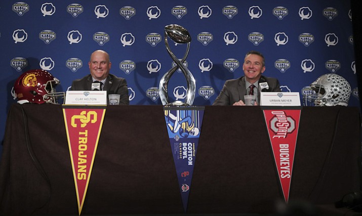 Southern California head coach Clay Helton, left, and Ohio State head coach Urban Meyer smile during a news conference for the Cotton Bowl NCAA college football game in Dallas, Thursday, Dec. 28, 2017. The game is scheduled for Friday, Dec. 29, 2017, in Arlington, Texas. (LM Otero/AP)