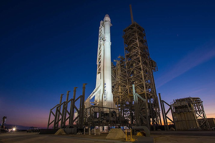 NASA provider SpaceX's Falcon 9 rocket and Dragon spacecraft are vertical at Launch Complex 39A at NASA's Kennedy Space Center in Florida.