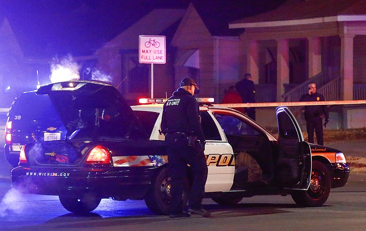 "Wichita police investigate a call of a possible hostage situation near the corner of McCormick and Seneca in Wichita, Ks Thursday night 12/28. A man was fatally shot by a police officer in what is believed to be a gaming prank called ""swatting."" (Fernando Salazar /The Wichita Eagle via AP)"