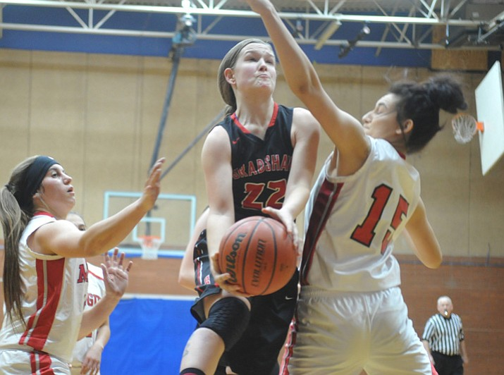 Bradshaw Mountain's Mica Nellis goes hard to the rim at the Lady Badgers Winter Classic on Friday, Dec. 29, 2017, in Prescott. (Les Stukenberg/Courier)