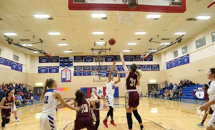Camp Verde sophomore Amanda Lozanilla shoots during the Cowboys' 59-50 loss to Surprise Shadow Ridge. The loss to the Stallions snapped Camp Verde's seven game win streak but the Cowboys haven't lost to a team in their conference or lower. SR is 5A. (VVN/ Halie Chavez)