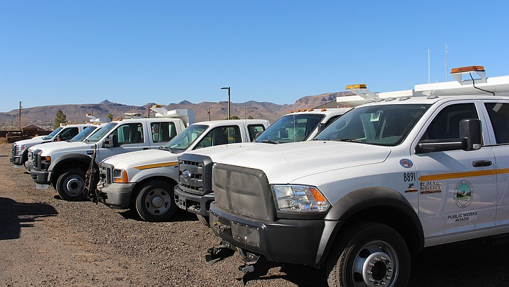 A fleet of Mohave County Public Works trucks are parked at the yard on Sunshine Drive. Mechanics, technicians and shop supervisors, along with office specialists, were approved for a 15.8 percent pay raise by the Board of Supervisors.