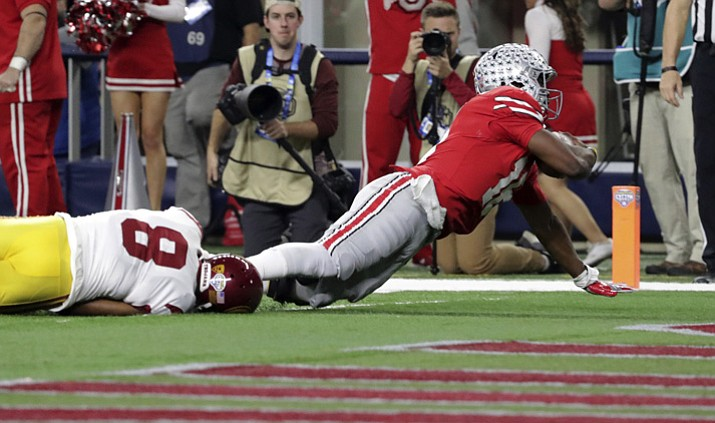 Ohio State quarterback J.T. Barrett scores a touchdown against Southern California cornerback Iman Marshall (8) during the first half of the Cotton Bowl on Friday, Dec. 29, 2017, in Arlington, Texas. (LM Otero/AP)