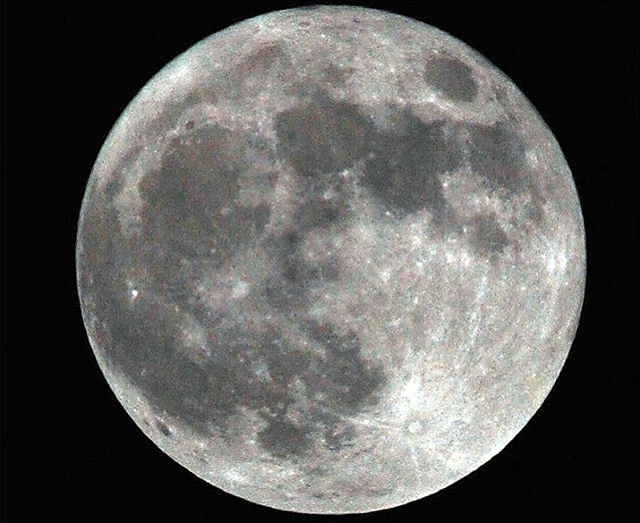 A shot of a supermoon in 2012 will likely pale by comparison to those tomorrow, Jan. 1. (Tim Wiederaenders/Courier, file)