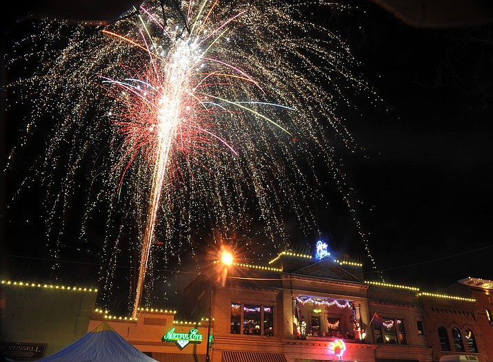 Fireworks light the sky during the 7th annual New Year's eve Whiskey Row Boot Drop in Prescott Sunday night.  (Les Stukenberg/Courier)