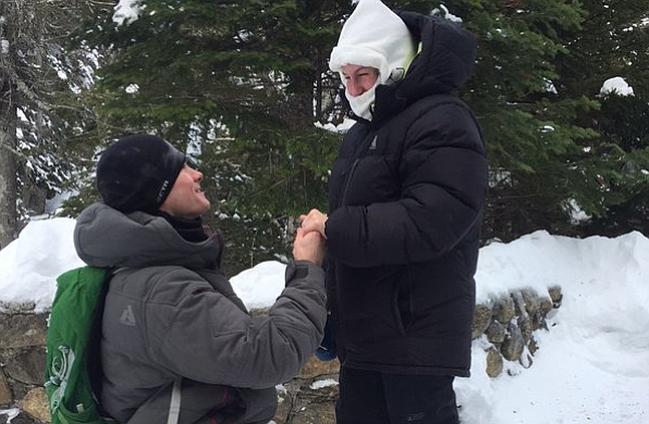 Josh Darnell, of Londonderry, New Hampshire, proposes to Rachel Raske, of Lowell, Massachusetts, on Thursday, Dec. 28, 2017, in Tuckerman's Ravine, New Hampshire, on the same day the temperature dropped to minus-34 (-37 Celsius) on nearby Mount Washington. Rachel Raske, of Lowell, Massachusetts, said yes. (AP Photo/Doug Darnell)