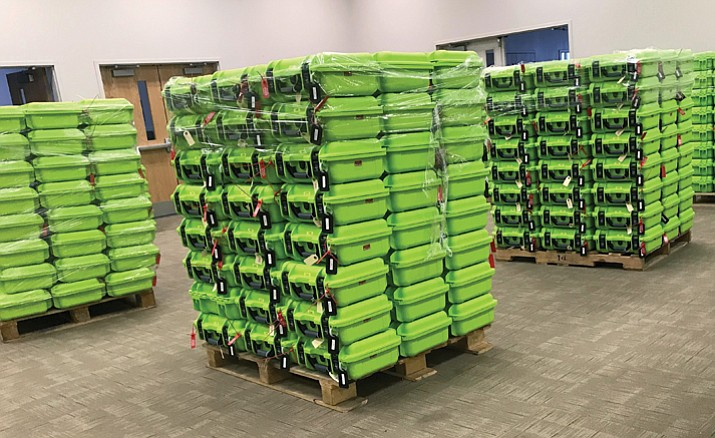 In this Dec. 14, 2017 photo, containers for secure ballot handling sit on pallets at the Franklin County Board of Elections in Columbus, Ohio. The Supreme Court will soon hear a case about Ohio's efforts to remove inactive voters from its rolls, which has become a flashpoint in a nationwide fight between Democrats and Republicans over access to the polls.