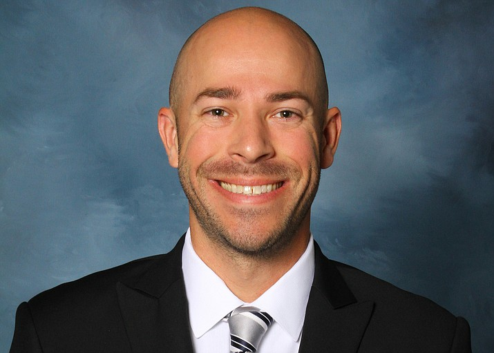 Justin Smith, an assistant women's basketball coach at the University of Dubuque, stopped a speeding bus after the driver passed out.