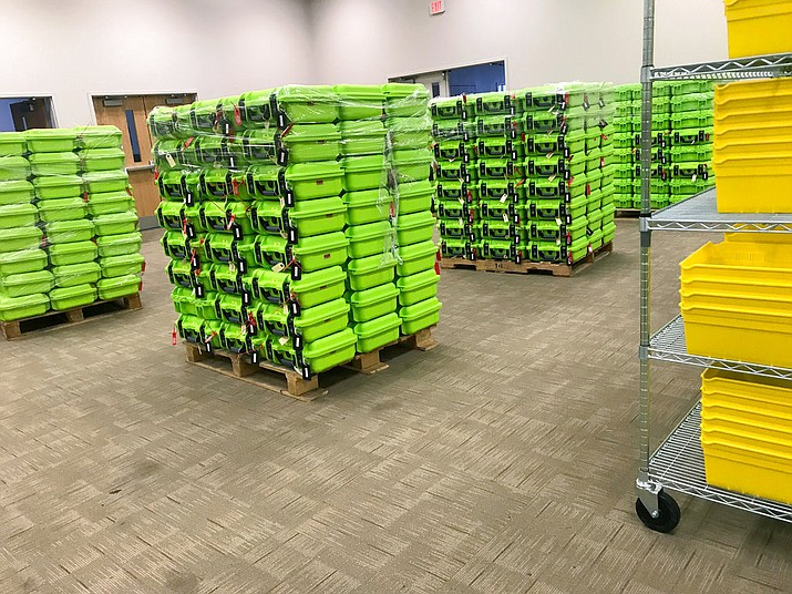 In this Dec. 14, 2017 photo, containers for secure ballot handling sit on pallets at the Franklin County Board of Elections in Columbus, Ohio. The Supreme Court will soon hear a case about Ohio's efforts to remove inactive voters from its rolls, which has become a flashpoint in a nationwide fight between Democrats and Republicans over access to the polls. The Trump administration is supporting Ohio's Republican-led government in defending its method for pruning voter rolls. Civil rights groups argue that federal law prohibits states from dropping eligible voters who have chosen not to cast ballots in some elections. (AP Photo/Julie Carr Smyth)