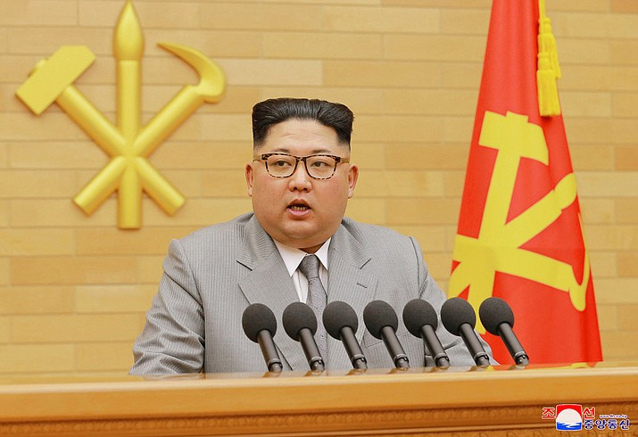 North Korean leader Kim Jong Un delivers his New Year's speech at an undisclosed place in North Korea Monday, Jan. 1, 2018. Kim said Monday the United States should be aware that his country's nuclear forces are now a reality, not a threat. Independent journalists were not given access to cover the event depicted in this image distributed by the North Korean government. (Korean Central News Agency/Korea News Service via AP)